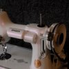 Singer Sewing machine with violet Ghost pearls ®