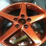 Orange copper metal Flake on a wheel
